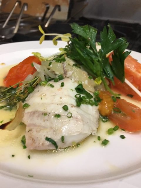 Baked sea bass with fresh thyme, onions, vine ripe tomatoes and Italian parsley.
