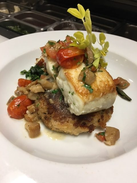 Roasted halibut with a Greek olive potato cake and porcini roasted baby heirloom tomatoes.